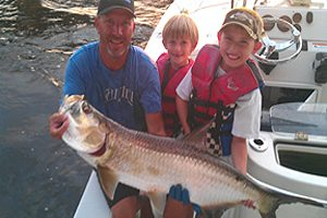 Florida guide service catching a tarpon and kids fishing